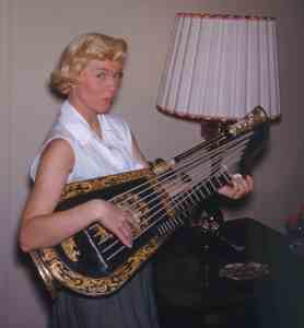 Doris Day at home with harp early 1950s