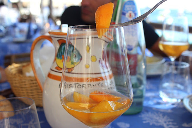 Wine with peaches at Maria Grazia restaurant in Nerano