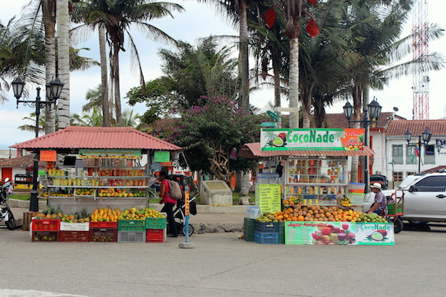 Fruit juices stalls in Salento main square, Colombia