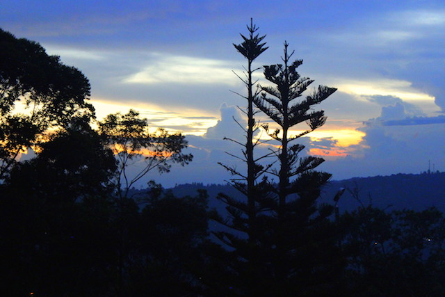 sunset on the lookpoint in Salento, Colombia
