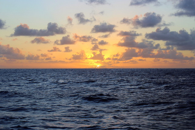 Sunset over the ocean while sailing from the Grenadines to Saint Lucie