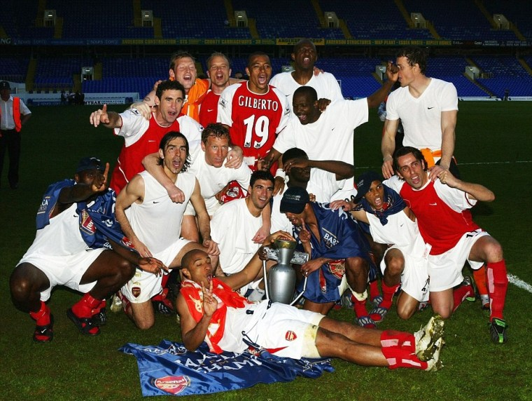 1413463193039_wps_17_Arsenal_celebrate_at_the_