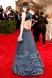 Katy Holmes wears a dress by Zac Posen