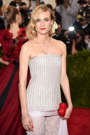 Diane Kruger wears Chanel Haute Couture two-piece embroidered ensemble and Judith Leiber clutch
