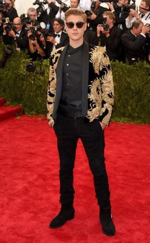 Justin Bieber wears a custom Balmain jacket with dragon design