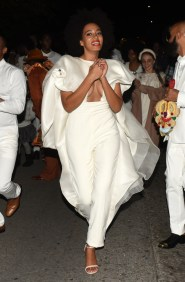 Solange attends to the wedding afterparty dressed in a Stéphane Rolland Spring 2014 Couture jumpsuit with cape