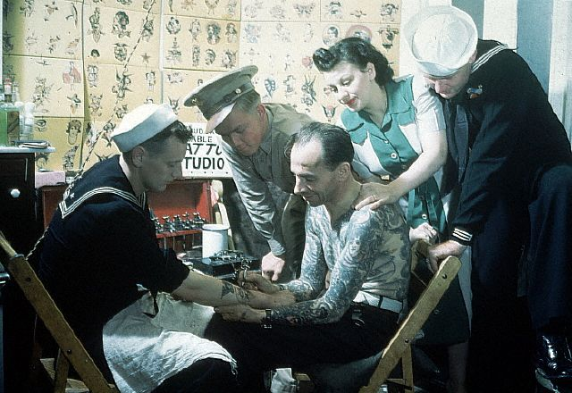 Franklin Paul Rogers tattooing a sailor  --circa, 1940s.