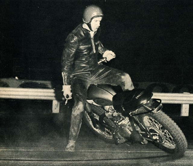 Kenny Brown, the mad motorcycyle trick-rider is seen here tearing it up on a Triumph.