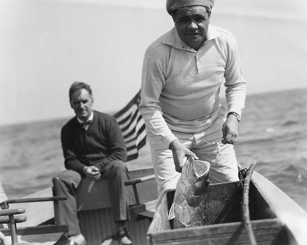 Original caption -- St. Petersburg, Flaorida: Babe Ruth & Fish. Babe Is A True Follower Of Izaak Walton. Babe Ruth, the Behemoth of swat of the Yankees, is mixing business with pleasure on his early start in Spring Training. Hauling in big fish may be sport, but at the same time, it keeps the muscles limber. -- Feb. 12th, 1935.