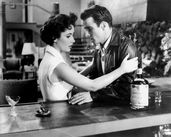"""Elizabeth Taylor and Montgomery Clift on the set of """"A Place in the Sun"""" -- ca. 1951. -- Image by © Sunset Boulevard"""