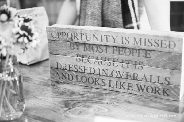 opportunity-is-missed-because-it-is-dressed-in-overalls-and-looks-like-work-black-white