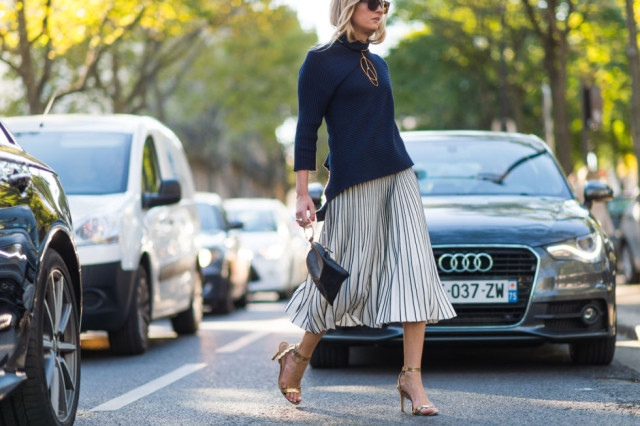 pleated-midi-skirt-navy-wrap-top-funnel-neck-top-gold-sandals-paris-fashion-week-street-style-fall-outfits-ell-640x426
