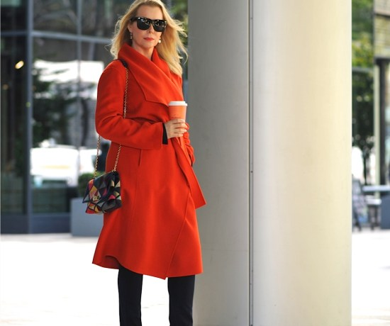 Windblown orange coat