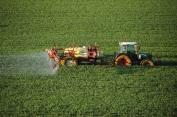 A farmer sprays a chemical fertilizer containing nitrogen on a wheat field in southern France. Nitrogen fertilizers are a known source of greenhouse gases.