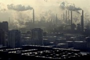 Benxi steel mills blowing smoke over residential buildings. Benxi was for long considered one of the most polluted city in China. Over the past decade thousands of workers have been made redundant as the city steel mills and power plants were closing down or reducing their output.