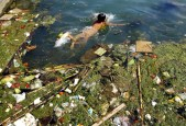 A child swims in a polluted reservoir in Pingba, in southwest China's Guizhou province Sept. 2, 2006.