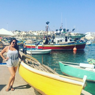 Lisa Vecchio in the seaside fishing village of Marsaxlokk, Malta