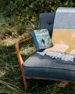 grey yellow panel wool blanket on armchair