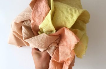 hand holding natural dyed fabrics