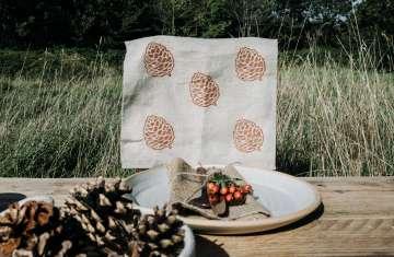 pinecone print tea towel table shot