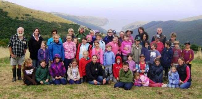 Group of school children at Hinewai Reserve with Hugh Wilson