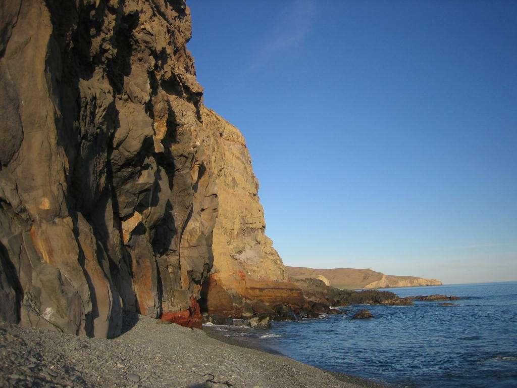 Sea cliffs of Banks Peninsula Birdlings Flat beach