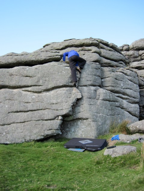 Me climbing the Flake problem on the Perched Block at Hound Tor.