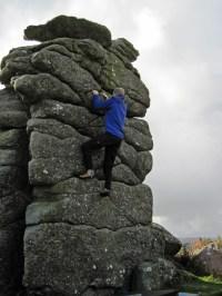 Me bouldering on Top Hat boulder at Hound Tor.