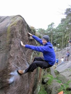 Climbing Classic Arete on The Big Block.