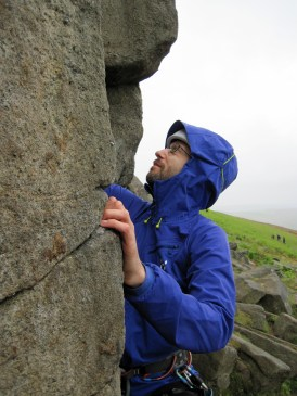 Climbing in the rain at Stanage.