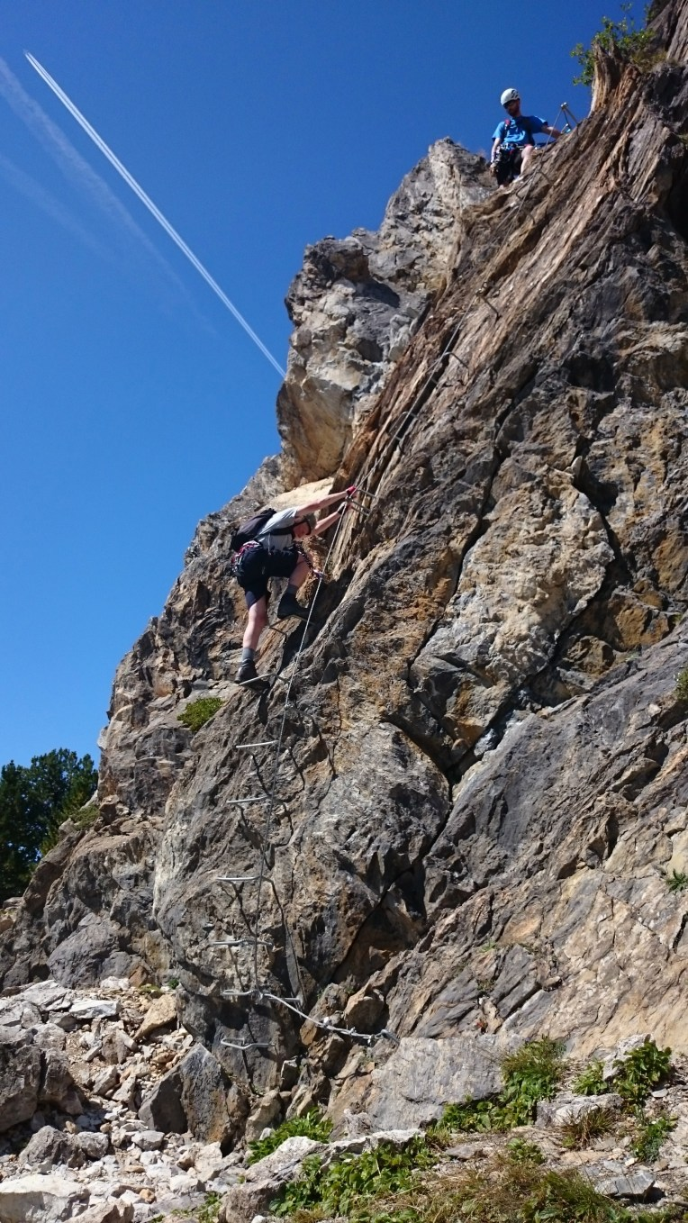John takes a big step down on the final section of the Klettersteig Knorren.