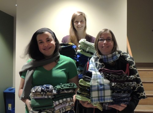 Sallie Carter, Kiela Crabtree, and Alysse Schultheis show off some of the scarves