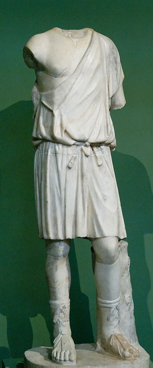 Young man wearing a chiton (tunic). Parian marble, copy after a Greek original of the 4th century BC. From the Horti Lamiani, 1874.