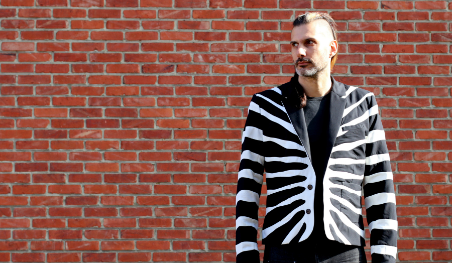 Joost wearing his Refashioners Zebra Jacket facing Front