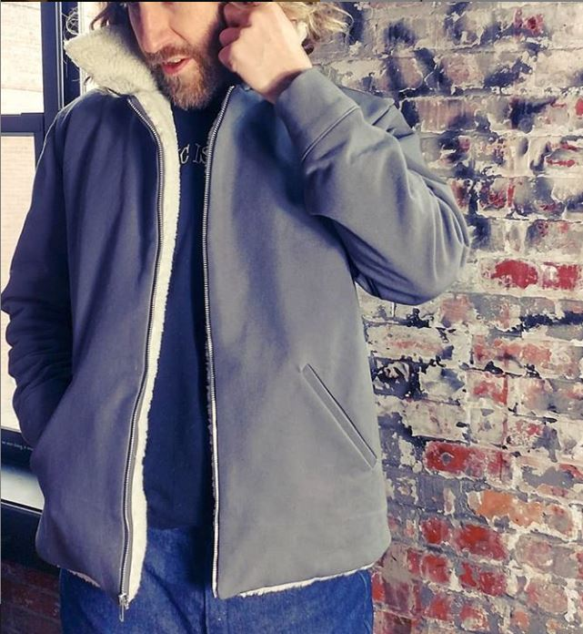 Picture of a bearded man wearing a grey wool-lined jacket.