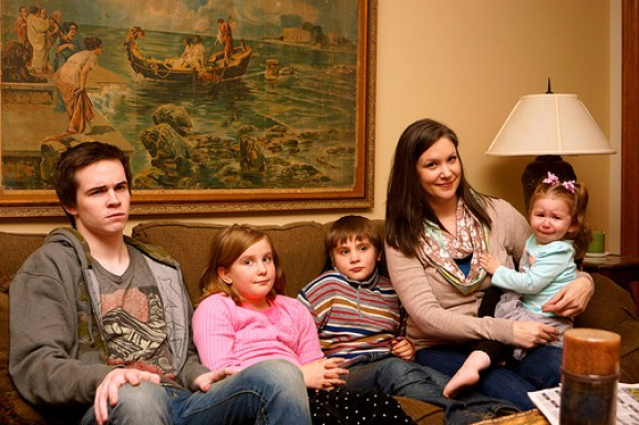 Picture of Becky Jo and her children, all of whom look grumpy.