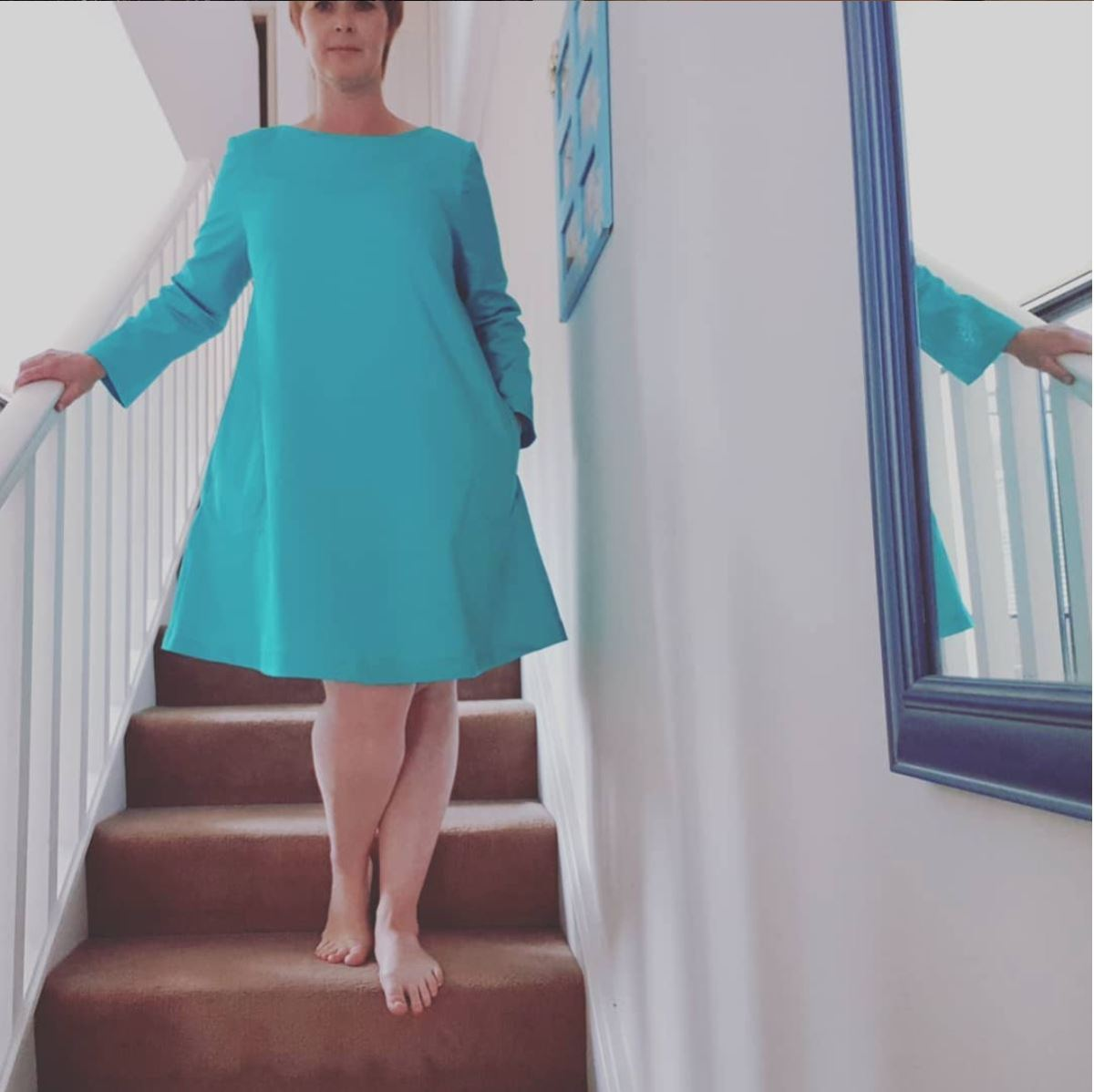 Bright blue turquoise swing dress with long sleeves