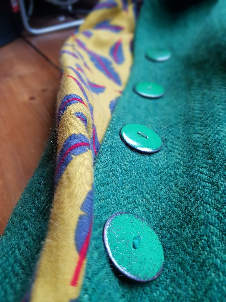 Green enamelled buttons in close up