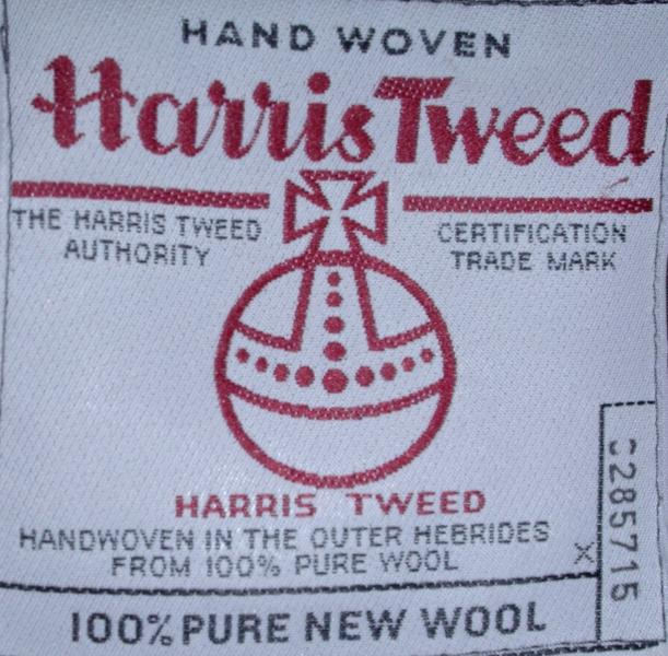 A close up of a label showing the red Harris Tweed orb, confirming that the garment is made using this specialist fabric.