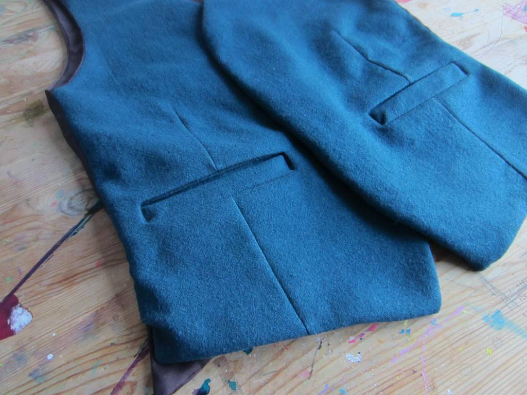 A close up of the waistcoat, finished except for the buttons and buttonholes.