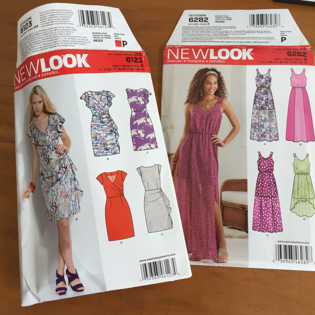Image shows package envelopes for New Look 6123, a knee-length wrap dress, and New Look 6282, a full-length sleeveless sundress
