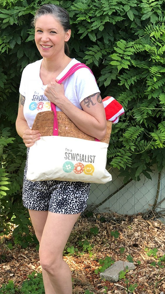 Sewcialists editor Becky - wearing a Sewcialists t-shirt and carrying a Sewcialists printed tote bag.