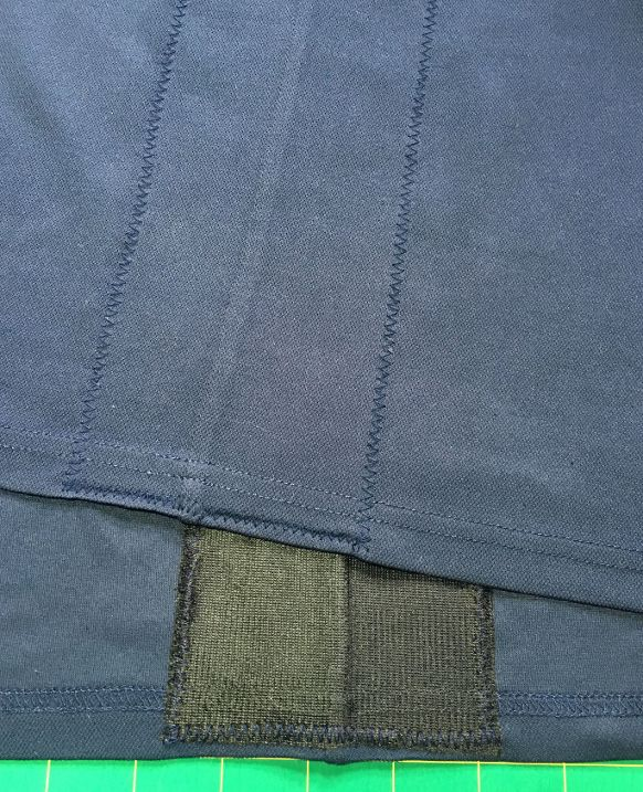 Image showing detail of inside and outside flat felled pocket seams.
