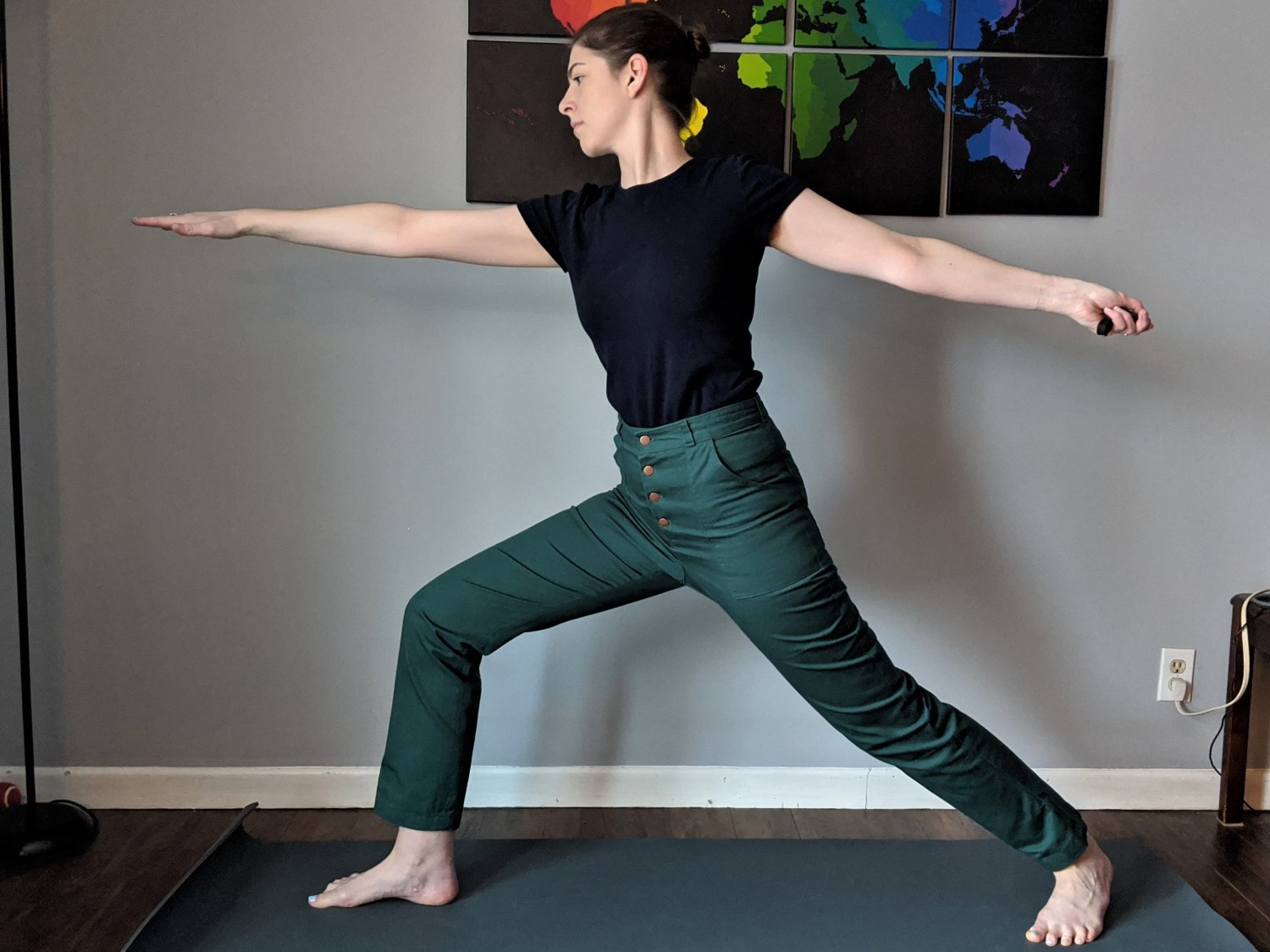 warrior 1 yoga pose in Lander pants