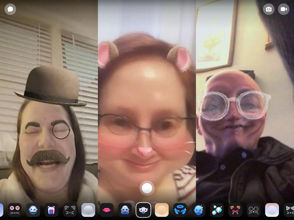 A screenshot from Facebook Messenger. Anne has a filter which adds a moustache, bowler, monocle, and eyebrows; Gillian's face is distorted to give her mouse cheeks and she has ears, a nose, and whiskers; and their father has giant white glasses and a distorted, pinched chin. All are laughing!