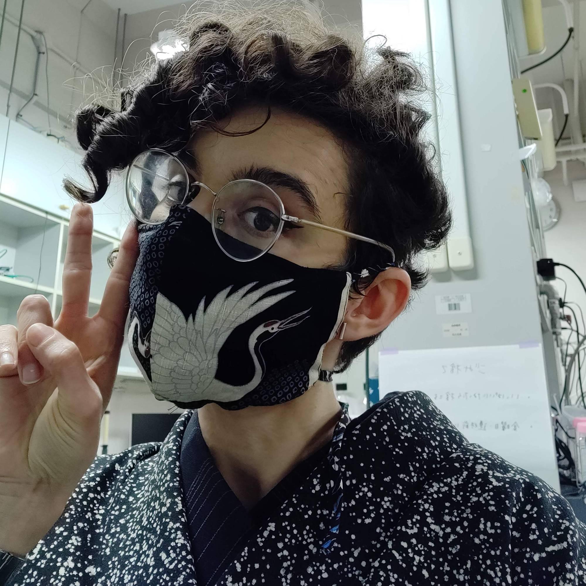 Emilia wearing a mask