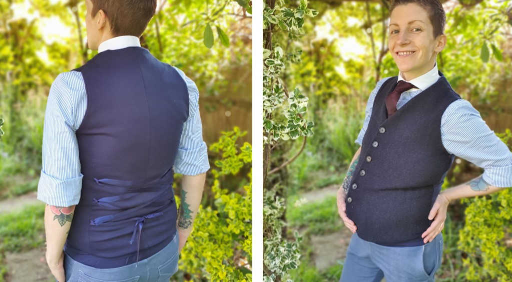 Emery wearing a navy wool waistcoat, this time at 28 weeks showing how the fit has changed.