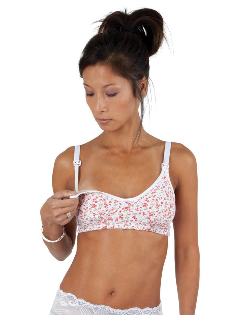 Person modeling a floral print nursing bra