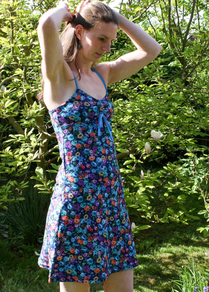 Person modeling a floral print tank top dress