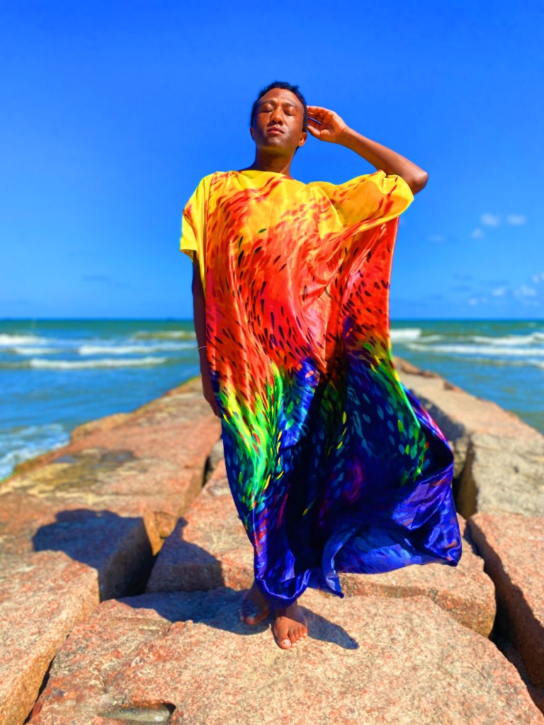 Terrance wears his handmade rainbow brush stroke caftan dress